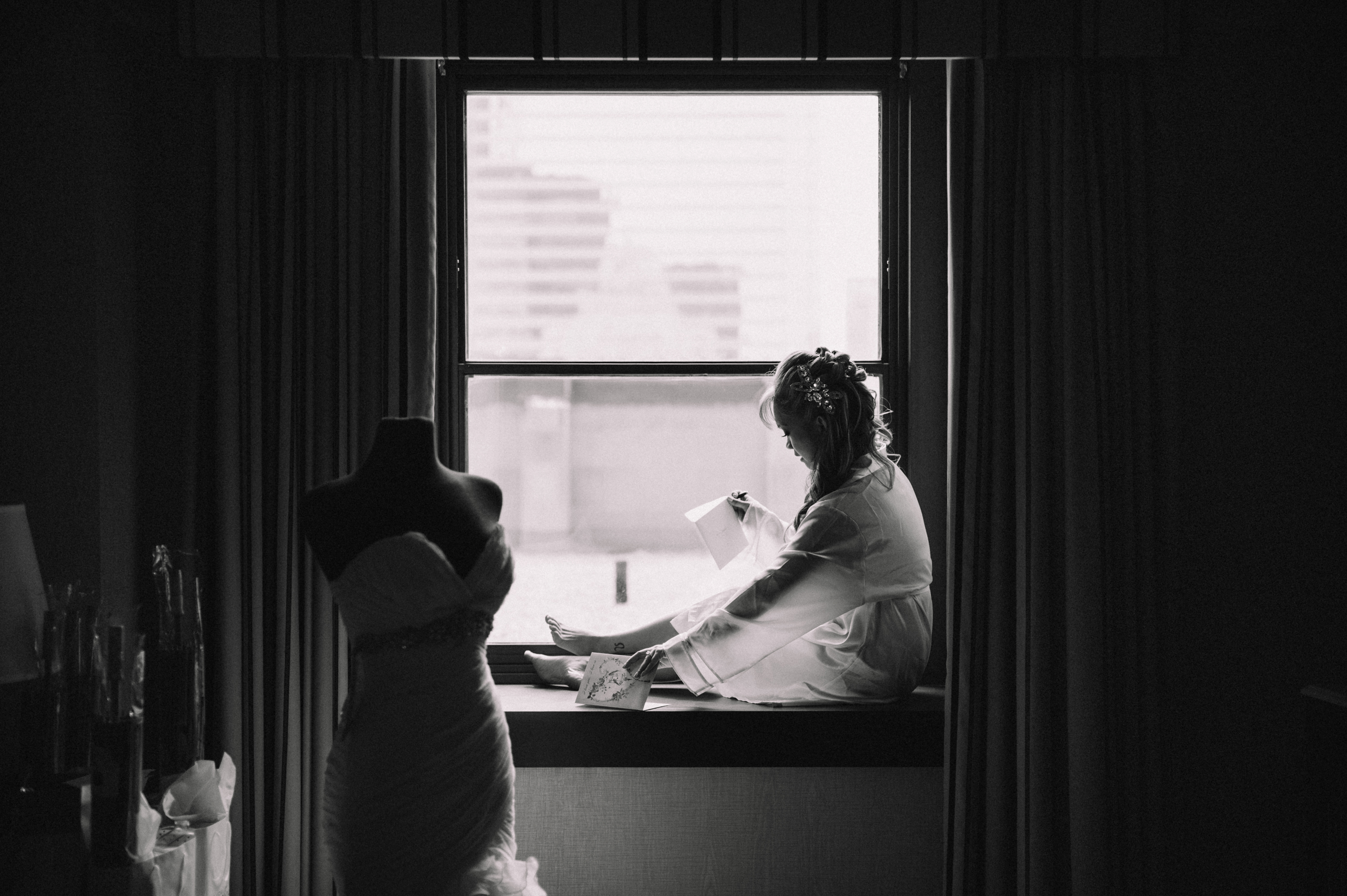 Bride reading letter from husband
