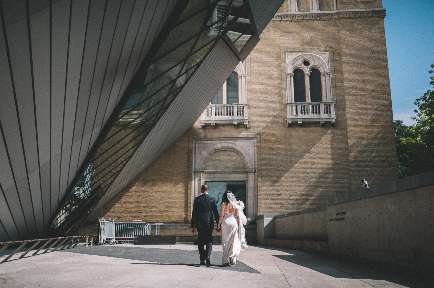 Bride and groom walking by the AGO