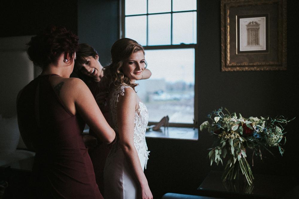 bride getting ready window light