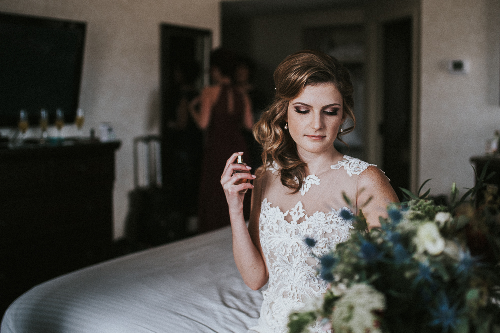 bride getting ready and putting her perfume on