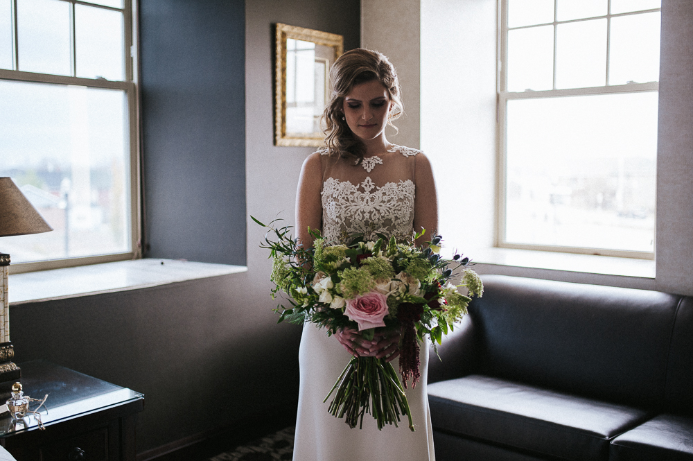 Bridal gown lace detail with a big bouquet