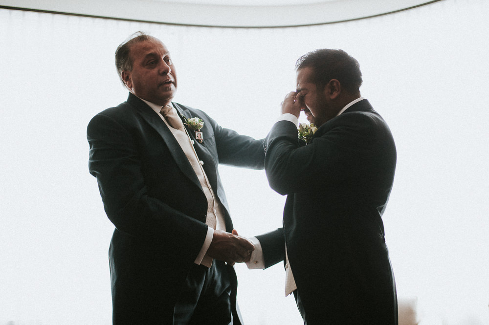 father and son emotional moment on the wedding day