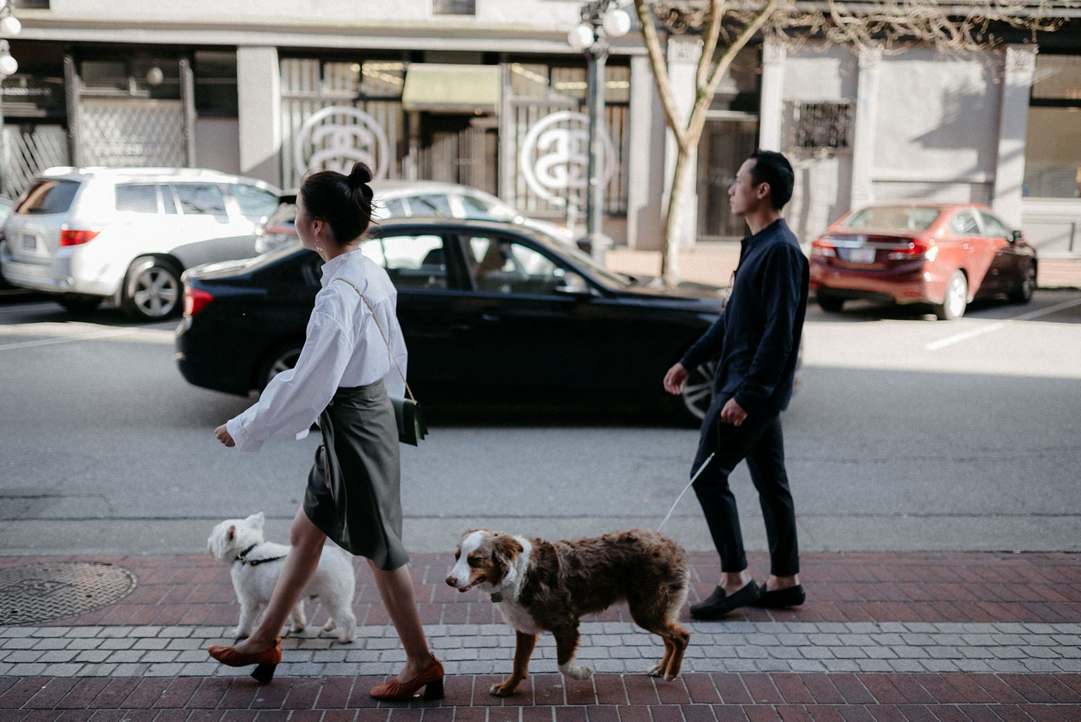 Sonia and Henry walking dogs in Gastown