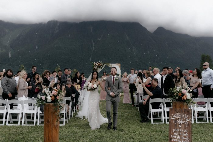 BRide and groom walking down the Isle at Fraser River Lodge
